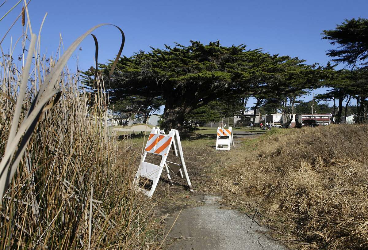 A cart path between the 14th and 15th holes is in need of repair at Sharp Park Golf Course in Pacifica, Calif. on Thursday, Jan. 16, 2014. Proposed improvements to a pump house and the cart path at the San Francisco city owned course worry environmentalists.