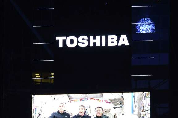 Space station astronauts Rick Mastracchio, left, Mike Hopkins and Koichi Wakata found time Dec. 31 to lead the New Year's Eve countdown on the giant television screen at Times Square in New York City.
