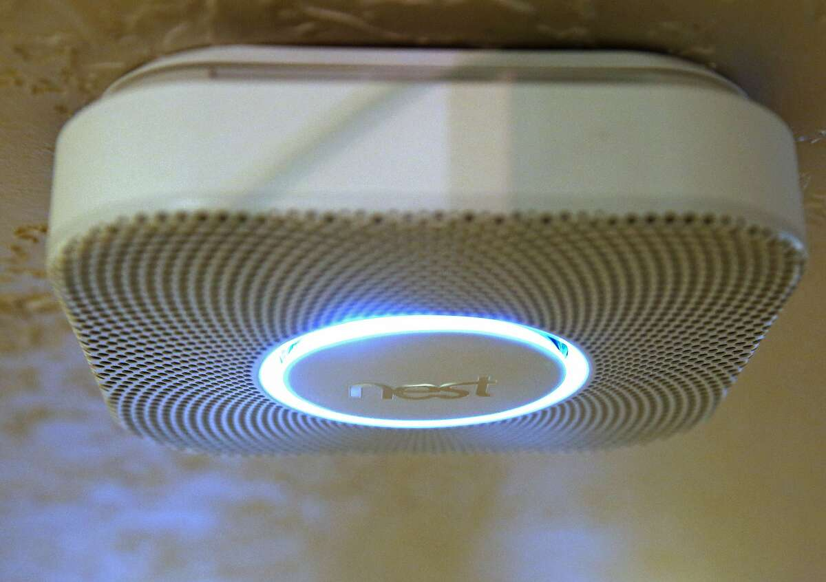 PROVO, UT - JANUARY 16: In this photo illustration, a Nest smoke and carbon monoxide detector installed in a home is seen on January 16, 2014 in Provo, Utah. Google bought Nest, a home automation company, for $3.2 billion taking Google further into the home ecosystem. (Photo illustration by George Frey/Getty Images)
