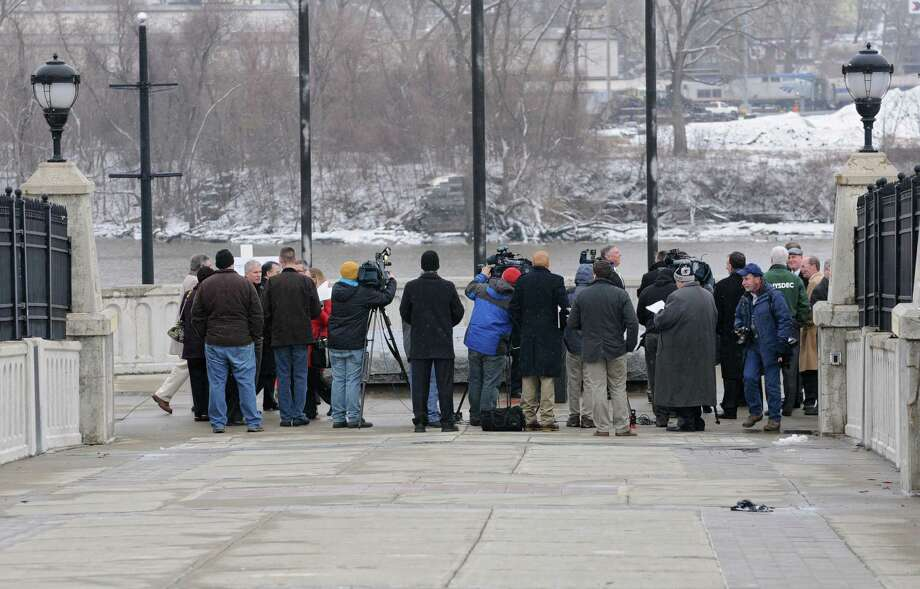 Members of the press gather on the Corning Preserve walkway for an announcement by State Department of Environmental Conservation Commissioner Joe Martens on $136 Million in upgrades to improve Hudson River water quality on Thursday, Jan. 16, 2014 in Albany, N.Y.  (Lori Van Buren / Times Union) Photo: Lori Van Buren / 00025385A