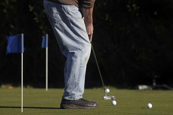A golfer practice putts before a round at Sharp Park Golf Course in Pacifica, Calif. on Thursday, Jan. 16, 2014. Proposed improvements to a pump house and a cart path at the San Francisco city owned course worry environmentalists.