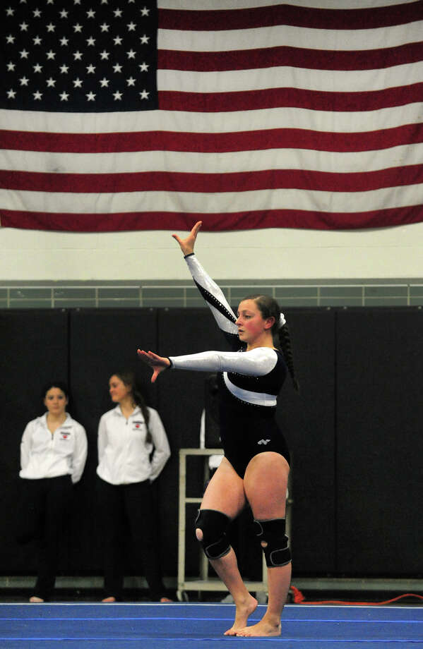 Foran's Katie Carino performs in the floor routine, during gymnastics action at Jonathan Law High in Milford, Conn. on Thursday January 16, 2014. Photo: Christian Abraham / Connecticut Post