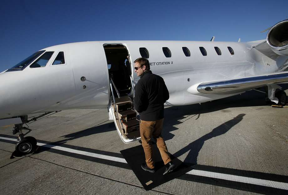 Brad Stewart, the President and CEO of XOJET, walks to one of their Cessna Citation X jets in San Francisco, Calif., on Monday, January 13, 2014. Photo: Sarah Rice, Special To The Chronicle