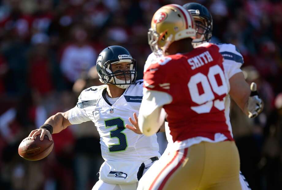 Seahawks vs. 49ers: Position-by-position breakdown Sunday's matchup between two bitter NFC West rivals will certainly be one of the most talked about games of the NFL season: a rubber match between two of the best teams in the league with a trip to Super Bowl XLVIII on the line. After each team beat the other on its home field, most recently a 19-17 49ers victory in San Francisco on Dec. 8, it seemed predestined that the Niners and Seahawks should meet in a winner-take-all playoff matchup. Despite the animosity between both teams and fan bases, the Niners and Hawks are remarkably similar. Both are led by former college coaches who imprinted their own personalities into the franchises. Both teams play a physical style of football that relies on the ground game and a punishing defense. And both rosters are stocked with players that make that system work.  Click through the gallery to see a breakdown of both rosters, position by position, as well as which team has the advantage in each. And know this before proceeding: Our judgment on nearly every position was incredibly close. Photo: Thearon W. Henderson, Getty Images