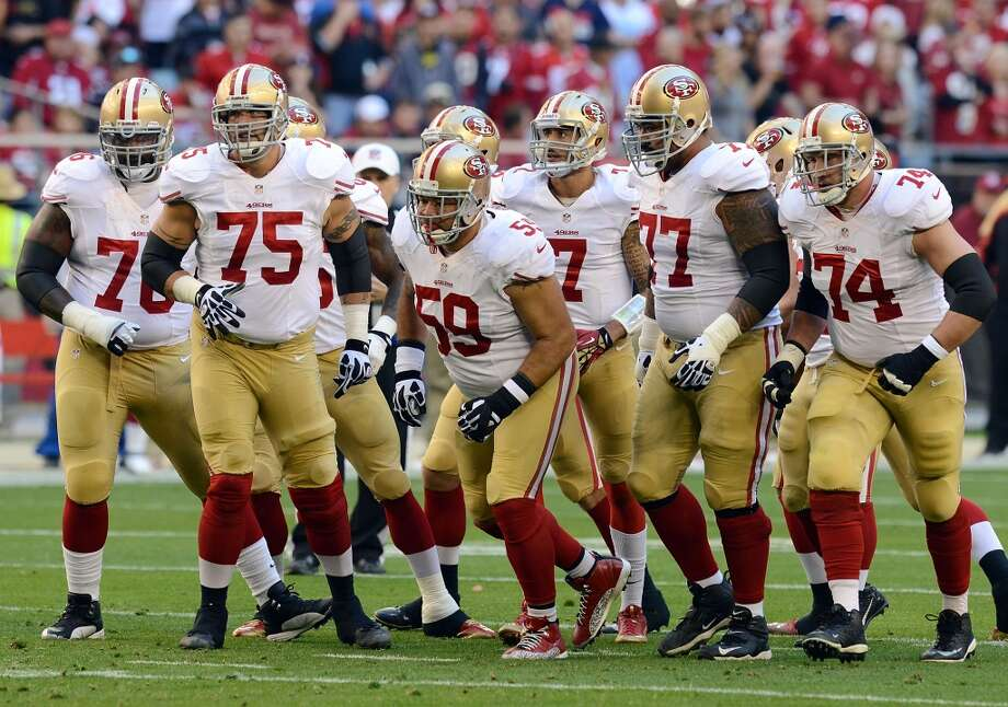 Offensive line First-round picks have a lot to live up to, but the three on the San Francisco offensive line seem to have met – if not exceeded – the lofty expectations placed upon them. After initially being labeled a disappointment, left tackle Joe Staley – the Niners' first-round selection in 2007 – has turned into one of the elite pass-protectors in the NFL, earning second-team All-Pro honors this season. Anthony Davis – the No. 11 overall pick in the 2010 draft – held down the right side for a line that ranked in the top third of the league in sacks allowed. Inside, former first-rounder Mike Iupati struggled with injuries, but still made his second straight Pro-Bowl appearance. Guard Alex Boone and 12-year veteran center Jonathan Goodwin round out a solid unit that helped the 49ers average 137.6 yards per game on the ground this season, good for third in the NFL. Conversely, the Seahawks' O-line struggled all season long. They certainly had their share of injuries, but even when starters Russell Okung, Paul McQuistan, Max Unger, J.R. Sweezy and Breno Giacomini were on the field at the same time, things just didn't seem to click. Perhaps – in the case of Okung struggling mightily against St. Louis Rams star Robert Quinn in Week 17 – it was simply a matter of not being completely healthy against top competition; maybe the transition from college defensive tackle to NFL guard proved too difficult at times for Sweezy; or it could have been former first-rounder James Carpenter shrinking under the weight of expectations. Whatever the case, the Hawks line was the team's glaring weakness in 2013. Advantage: 49ers Photo: Norm Hall, Getty Images
