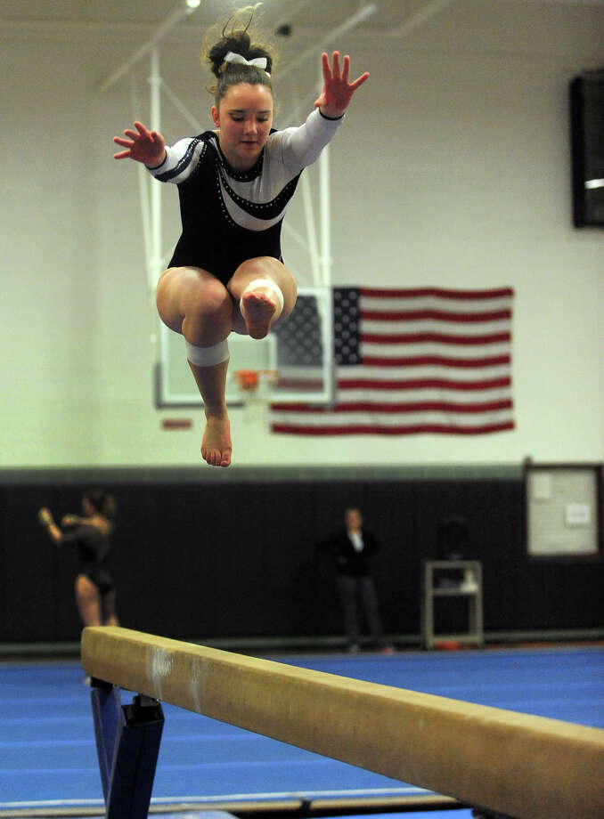 Foran's Haley Alicki competes on the balance beam, during gymnastics action at Jonathan Law High in Milford, Conn. on Thursday January 16, 2014. Photo: Christian Abraham / Connecticut Post