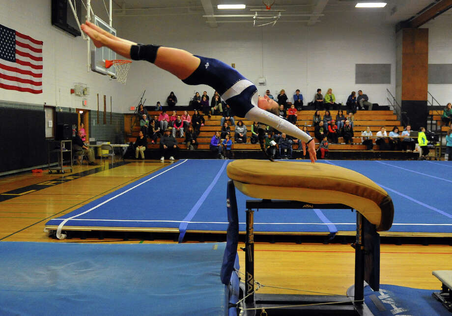 Foran's Katie Carino performs on the vault, during gymnastics action at Jonathan Law High in Milford, Conn. on Thursday January 16, 2014. Photo: Christian Abraham / Connecticut Post