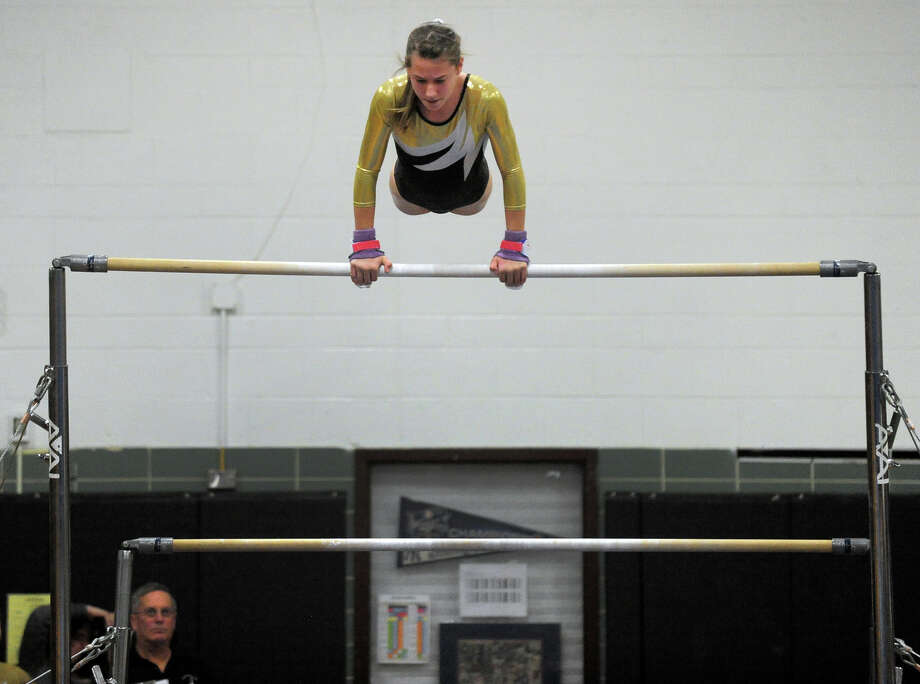 Gymnastics action between Foran and Jonathan Law in Milford, Conn. on Thursday January 16, 2014. Photo: Christian Abraham / Connecticut Post