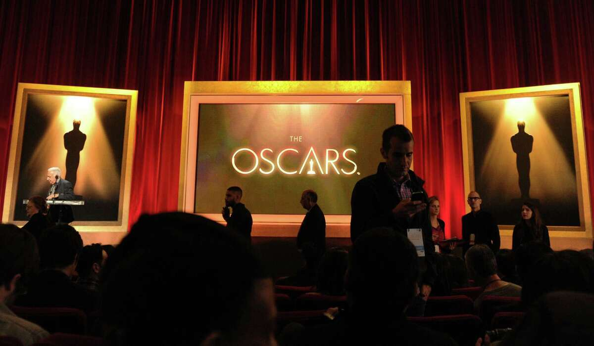 Reporters wait for the start of the Oscar nominations announcement in Beverly Hills.