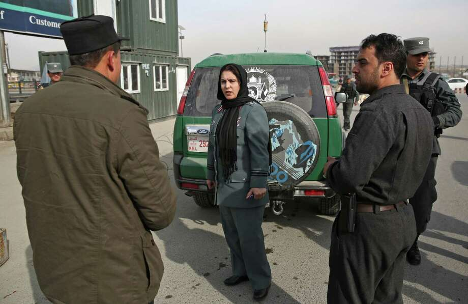 Despite recent attacks on other prominent women in the country, the highest-ranking Afghan policewoman said she is not afraid to be in the spotlight. Photo: Massoud Hossaini, STF / AP