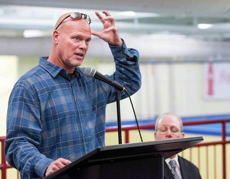Jim McMahon, former Chicago Bears quarterback, speaks to an audience at Chelsea Piers Stamford, CT about being a patient of Dr. Scott Rosa, a cranio-cervical specialist, and Dr. Rosa's procedure on treating cranio-cervical issues. Thursday, January, 16th, 2014. Photo: Mark Conrad / Connecticut Post Freelance