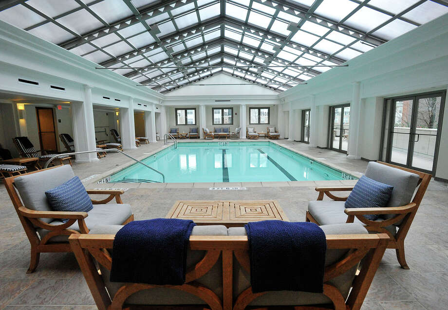 The pool at the Highgrove luxury apartment complex is available for all residents. Part of the glass roof opens to the sky on warm days. The Highgrove is located in Stamford, Conn. Photographed on Thursday, Jan. 16, 2014. Photo: Jason Rearick / Stamford Advocate