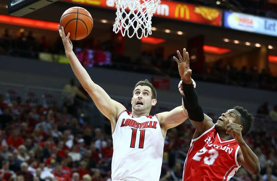 LOUISVILLE, KY - JANUARY 16:  Luke Hancock #11  of the Louisville Cardinals shoots the ball during the game against the Houston Cougars at KFC YUM! Center on January 16, 2014 in Louisville, Kentucky.  (Photo by Andy Lyons/Getty Images) Photo: Getty Images