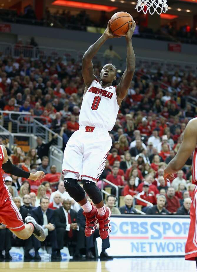 LOUISVILLE, KY - JANUARY 16: Terry Rozier #0 of the Louisville Cardinals shoots the ball during the game against the Houston Cougars at KFC YUM! Center on January 16, 2014 in Louisville, Kentucky.  (Photo by Andy Lyons/Getty Images) Photo: Getty Images