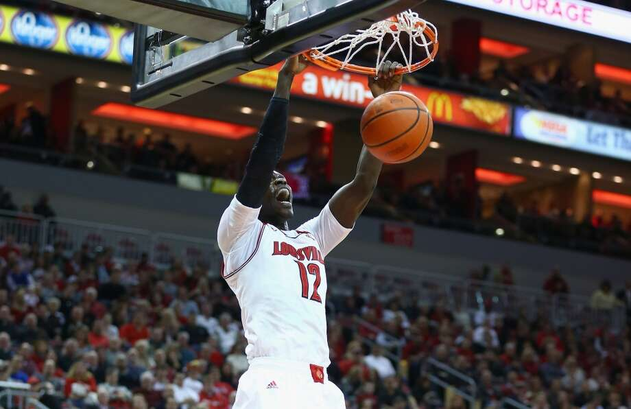LOUISVILLE, KY - JANUARY 16:  Mangok Mathiang #12 of the Louisville Cardinals dunks the ball during the game against the Houston Cougars at KFC YUM! Center on January 16, 2014 in Louisville, Kentucky.  (Photo by Andy Lyons/Getty Images) Photo: Getty Images