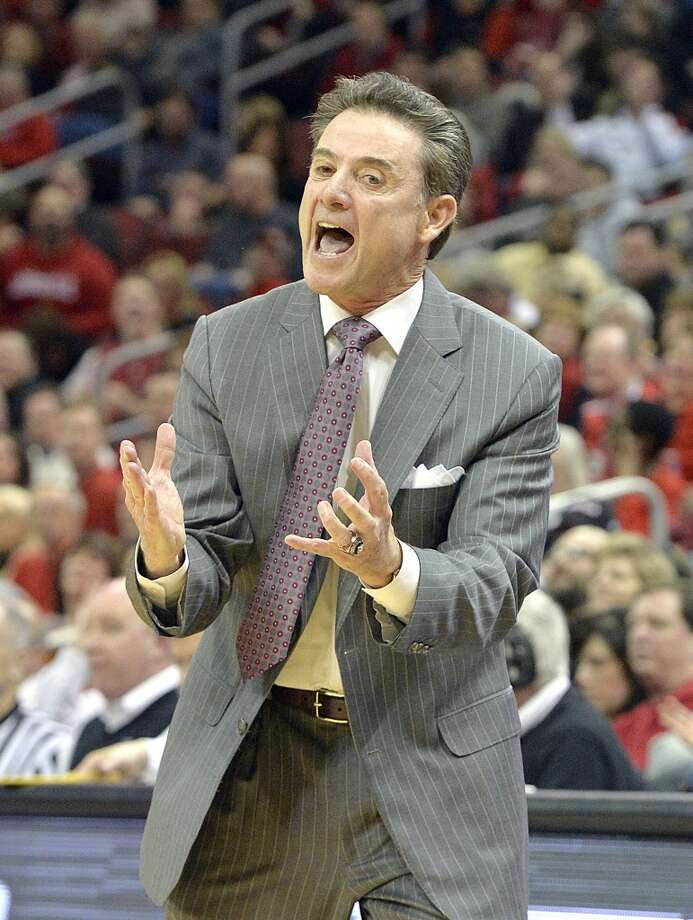 Louisville head coach Rick Pitino shouts instructions to his team during the first half of an NCAA college basketball game against Houston, Thursday, Jan. 16, 2014, in Louisville, Ky. (AP Photo/Timothy D. Easley) Photo: Associated Press