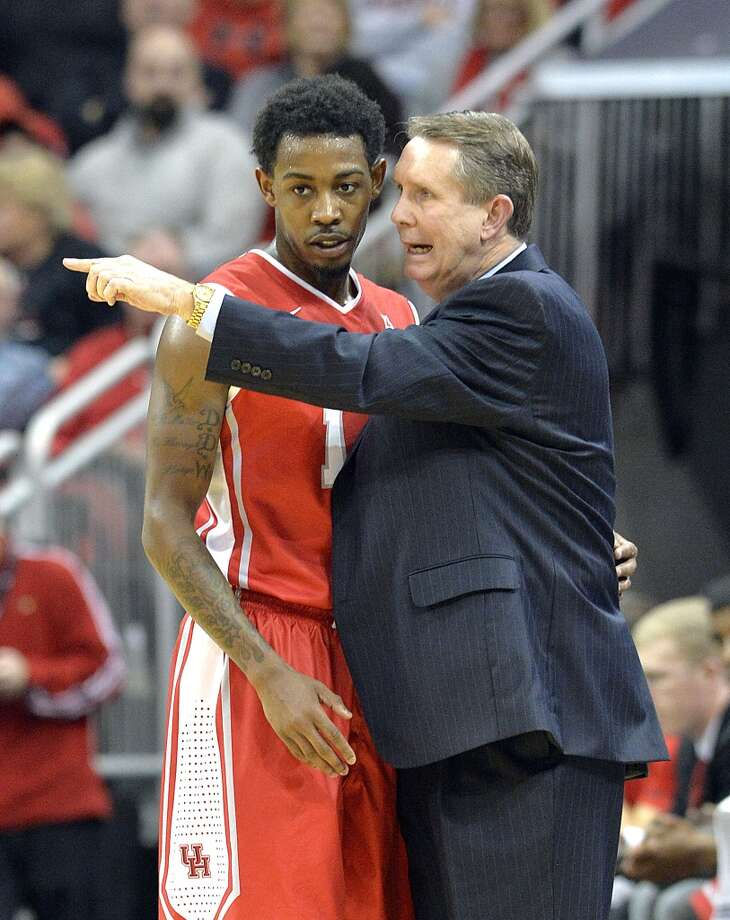 Houston head coach James Dickey, right, talks with Tione Womack during the first half of an NCAA college basketball game against Louisville, Thursday, Jan. 16, 2014, in Louisville, Ky. (AP Photo/Timothy D. Easley) Photo: Associated Press