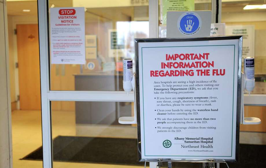 Flu alert signs are placed at the front doors of Albany Memorial Hospital on Thursday, Jan. 16, 2014, in Albany, N.Y. Capital Region hospitals are taking steps to keep flu from spreading by temporarily restricting visitors. The steps go into effect Friday because of increasing numbers of cases of influenza (Type A-H1N1) across the state and in the Capital Region.  (Lori Van Buren / Times Union) Photo: Lori Van Buren