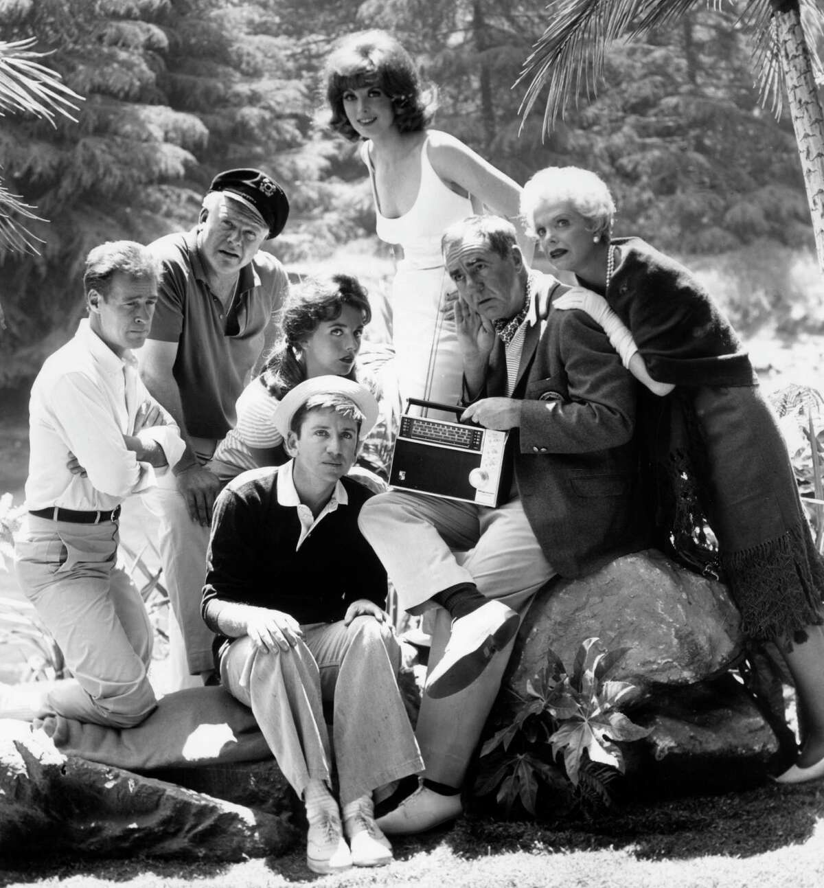 """The cast of """"Gilligan's Island"""" (left to right): Russell Johnson, Alan Hale Jr., Dawn Wells, Bob Denver, Tina Louise, Jim Backus and Natalie Schafer. Johnson died Thursday."""