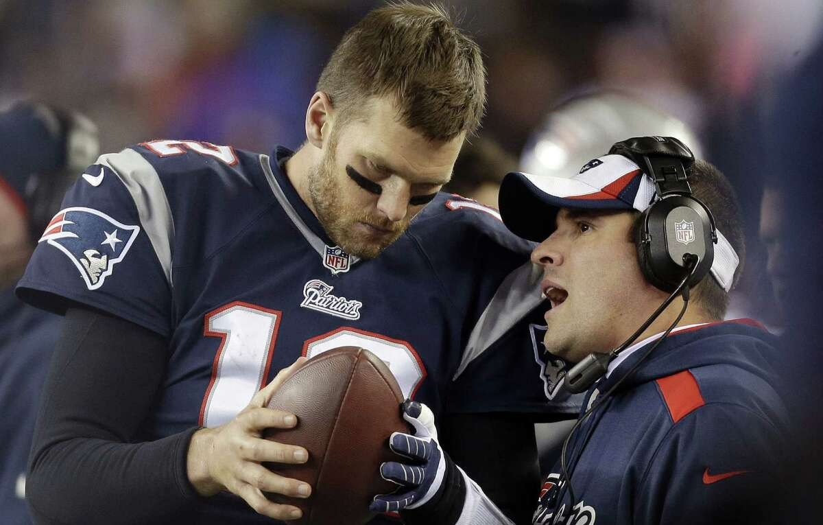 Josh McDaniels (right) is back as the Patriots' offensive coordinator, almost four years after he was fired as Broncos coach.