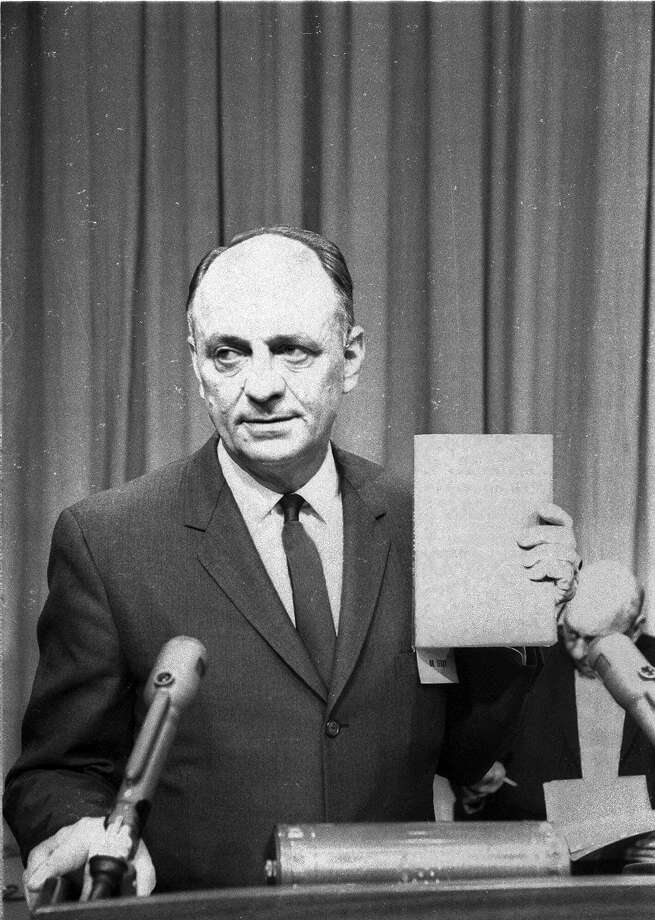 U.S. Surgeon General Luther Terry holds a copy of the 387 page report of the Advisory Committe to the Surgeon General of the Public Health Service on the relationship of smoking to health Jan. 11, 1964.  He spoke at a Washington news conference at which the study was released.  It termed smoking a health hazard calling for corrective action. (AP Photo/hwg) ORG XMIT: NY127 Photo: HWG / AP