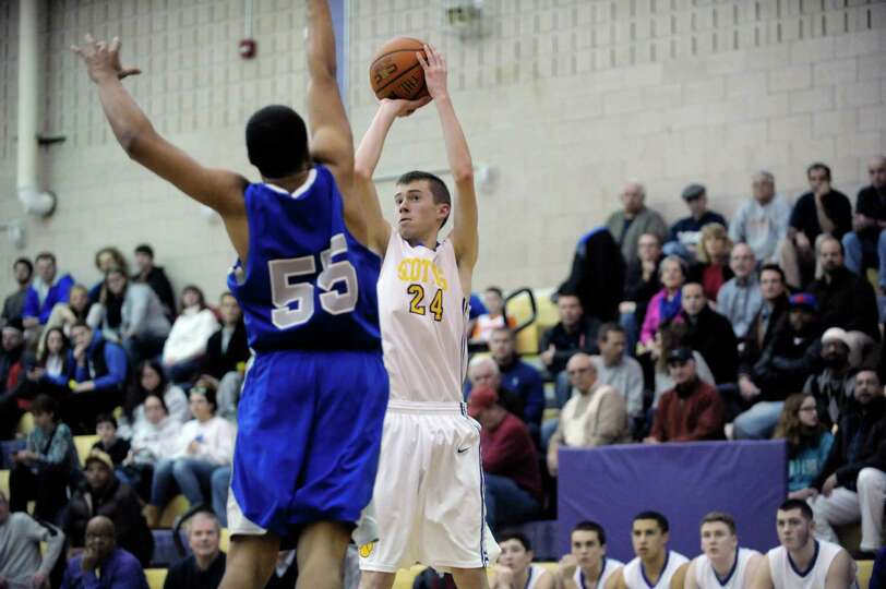 Saratoga's Jesse Alexander, left, gets out to defend as Ballston Spa's Sean Walsh puts up a shot dur