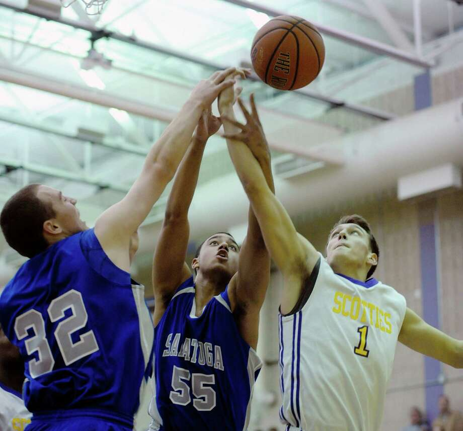 Saratoga's Zack Kircher, left, and Jesse Alexander, center, battle for a rebound against Ballston Spa's Jeremy Mendrick during a boy's basketball game on Thursday, Jan. 16, 2014 at Ballston Spa High School in Ballston Spa, NY.   (Paul Buckowski / Times Union) Photo: Paul Buckowski / 00025382A