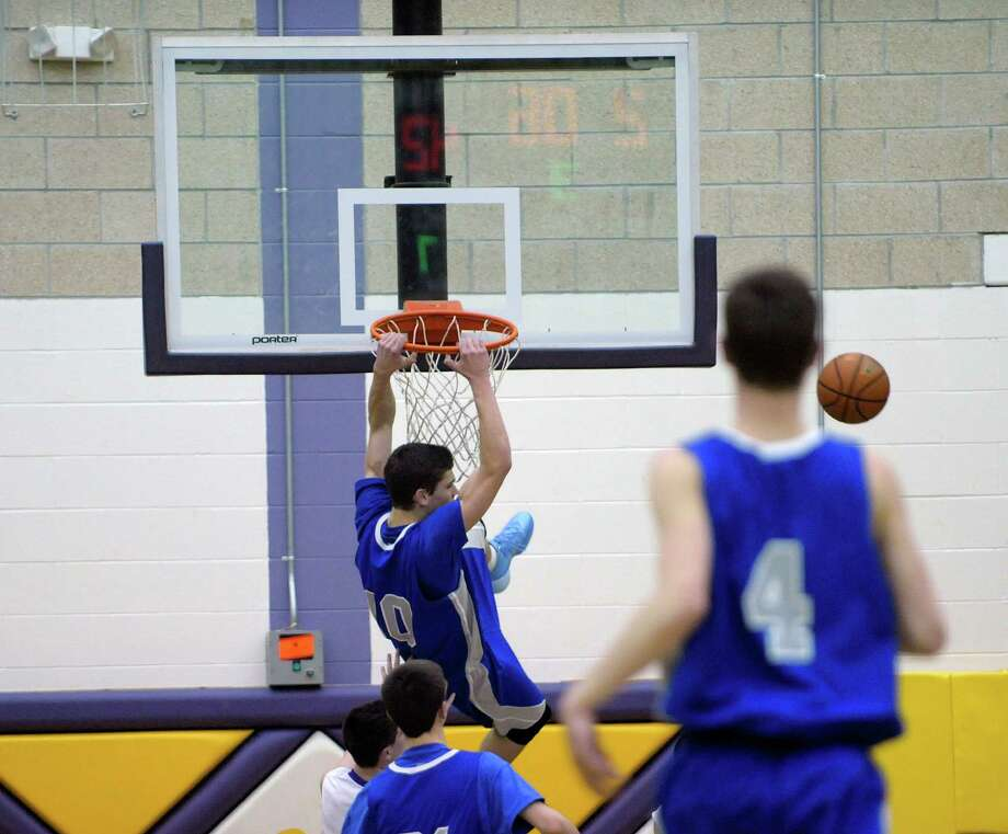 Saratoga's Noah Arciero misses on a dunk attempt against Ballston Spa during a boy's basketball game on Thursday, Jan. 16, 2014 at Ballston Spa High School in Ballston Spa, NY.   (Paul Buckowski / Times Union) Photo: Paul Buckowski / 00025382A
