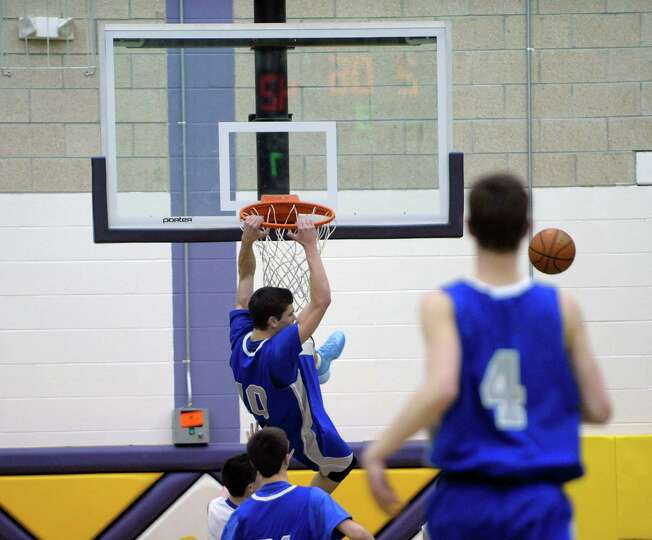 Saratoga's Noah Arciero misses on a dunk attempt against Ballston Spa during a boy's basketball game