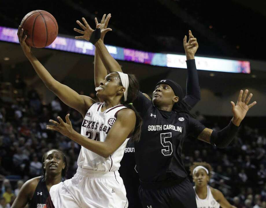 A&M's Jordan Jones goes past South Carolina's Khadijah Sessions en route to the basket in the first half. Jones was one of four Aggies who scored in double figures, contributing 16 points. She also had four steals as A&M improved to 4-0 in the SEC. Photo: Patric Schneider / Associated Press / FR170473 AP