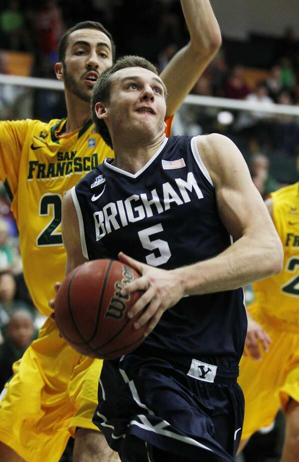 Kyle Collinsworth had 19 points to lead five BYU players in double-figure scoring. USF's Mark Tollefsen (left) had 11 points and five rebounds. Photo: George Nikitin, Associated Press