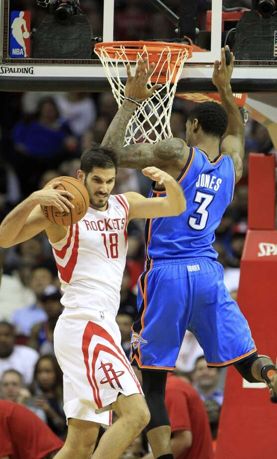 Jan. 16: Thunder 104, Rockets 92  Rockets small forward Omri Casspi (18) grabs the rebound from Thunder small forward Perry Jones. Photo: Karen Warren, Houston Chronicle