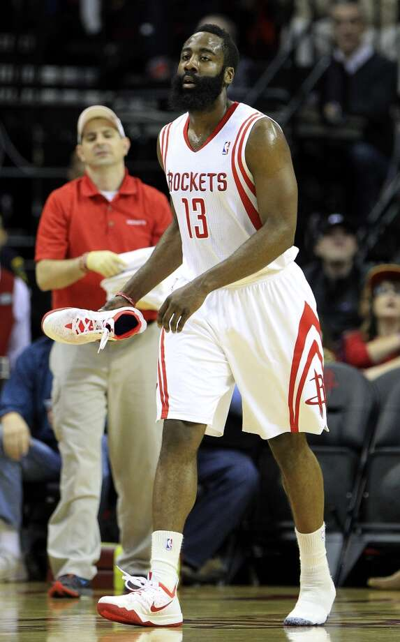 Rockets shooting guard James Harden (13) walks back to the huddle with his shoe. Photo: Karen Warren, Houston Chronicle
