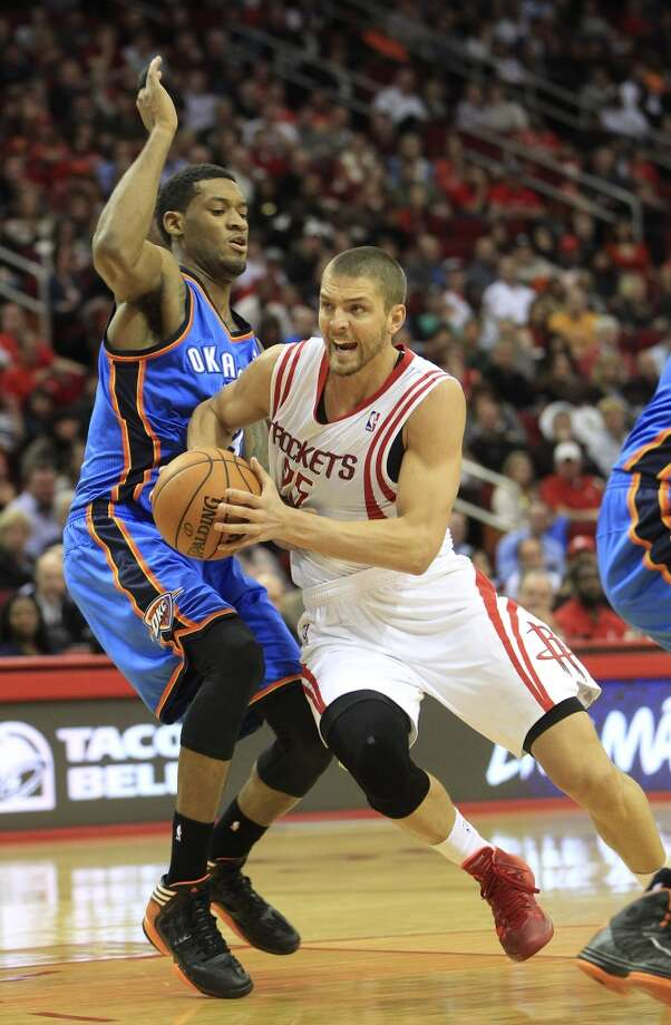 Rockets small forward Chandler Parsons (25) drives around Thunder small forward Perry Jones. Photo: Karen Warren, Houston Chronicle