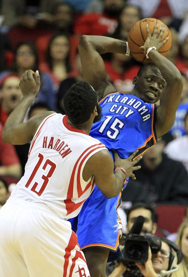 Rockets shooting guard James Harden (13) defends the basket from Thunder point guard Reggie Jackson. Photo: Karen Warren, Houston Chronicle