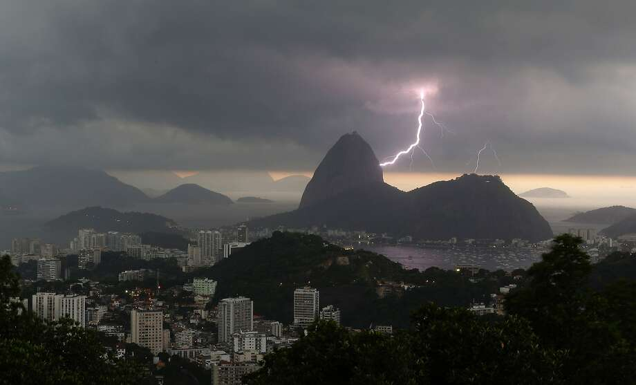 Lightning lights up the the sky over Sugar Loaf mountain in Rio de Janeiro, Brazil, Thursday, Jan.16, 2014. An alert was called by Rio authorities due to heavy rains and the possibilty of floods in the city. (AP Photo/Leo Correa) Photo: Leo Correa, Associated Press