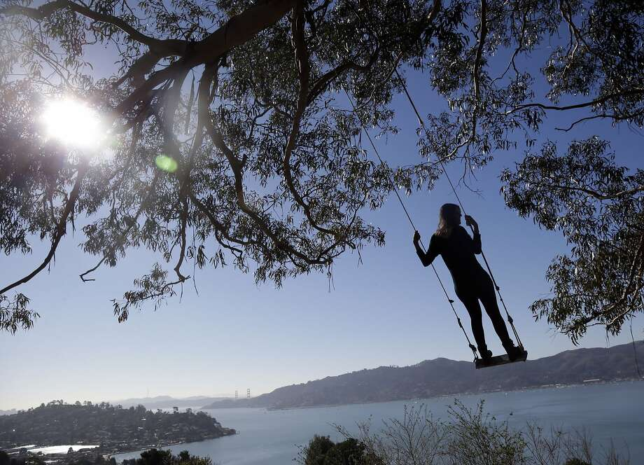 Out on a limb: Claudia Hoffmann of Aachen, Germany, swings from the Hippie Tree, a popular visitors' spot overlooking 