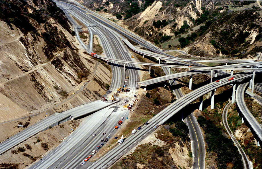 Twenty years the magnitude temblor took the life of a motorcycle police officer on this section of freeway at 4.31am on January 17, 1994. The earthquake centered in the Northridge area of Los Angeles' San Fernando Valley killed 57 people in total and caused $15 billion in damage. Photo: Paul Harris, Getty Images / Hulton Archive