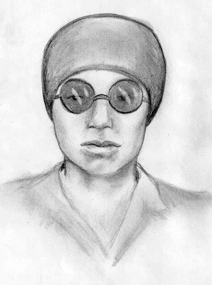 This suspect is accused of wearing John Lennon's glasses. Photo: SLPD