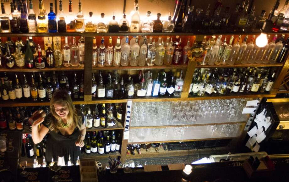 The way it was:Sarah Guichard works behind the bar at Marfreless . Photo: J. Patric Schneider, For The Chronicle