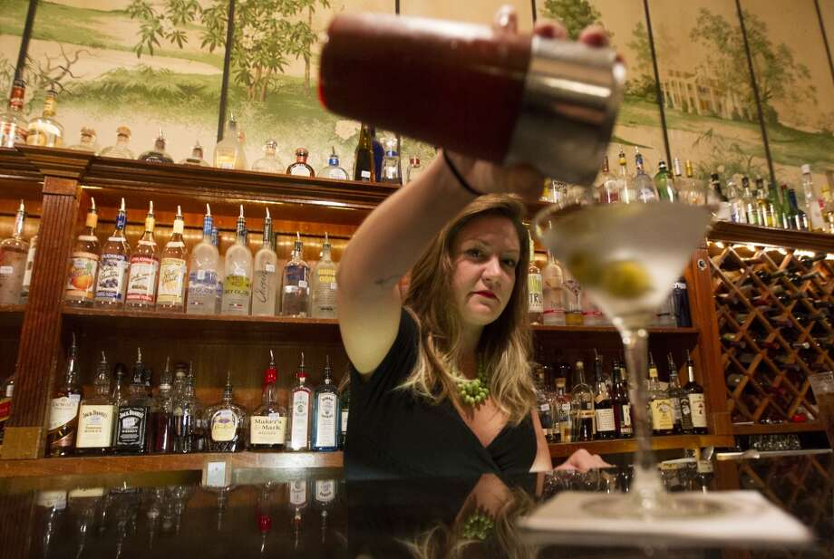 The way it was:  Bartender Sarah Guichard pours a martini . Photo: J. Patric Schneider, For The Chronicle