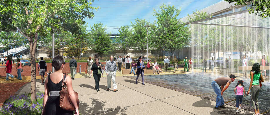 An artist's rendering of a more welcoming transportation center in downtown Bridgeport shows the corner of John and Water streets, looking toward the train tracks, with a rain fountain. Photo: Contributed Photo / Connecticut Post Contributed