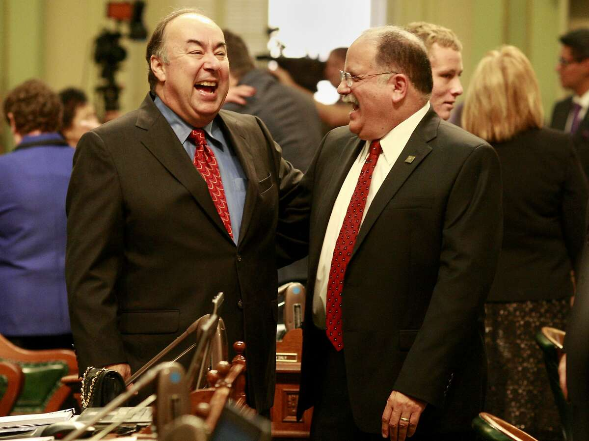 Fresno Assemblyman Richard Gordon (right) laughed with a colleague as the ceremonies ended. The new California legislature was sworn in during a ceremony Monday December 3, 2012 at the state capitol at the Assembly chambers in Sacramento, Calif.