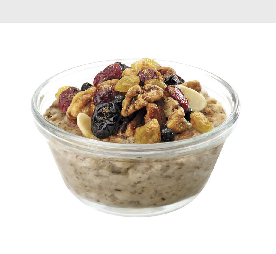Starting Monday, July 25, Chick-fil-A will introduce Multigrain Oatmeal to its menu. Customers can choose one of three toppings, including cinnamon brown sugar, roasted mixed nuts (almonds, pecans and walnuts) or a dried fruit blend (cranberries, blueberries, golden raisins and cherries). A serving of oatmeal contains 120 calories and 2.5 grams of fat without toppings and up to 290 calories and 11 grams of fat with the addition of toppings, all with no trans fat.  (PRNewsFoto/Chick-fil-A, Inc.) Photo: HO / CHICK-FIL-A, INC.