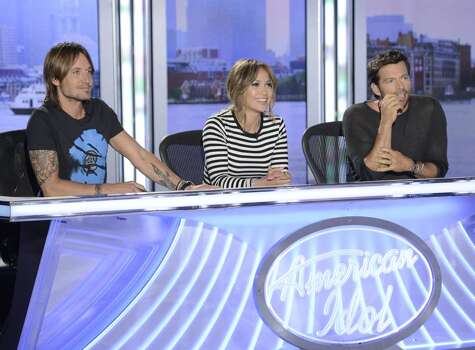 Judges Keith Urban, Jennifer Lopez and Harry Connick, Jr. get along but are very different in their critiques. Photo: Michael Becker / FOX. © Copyright 2013 FOX Broadcasting Co.