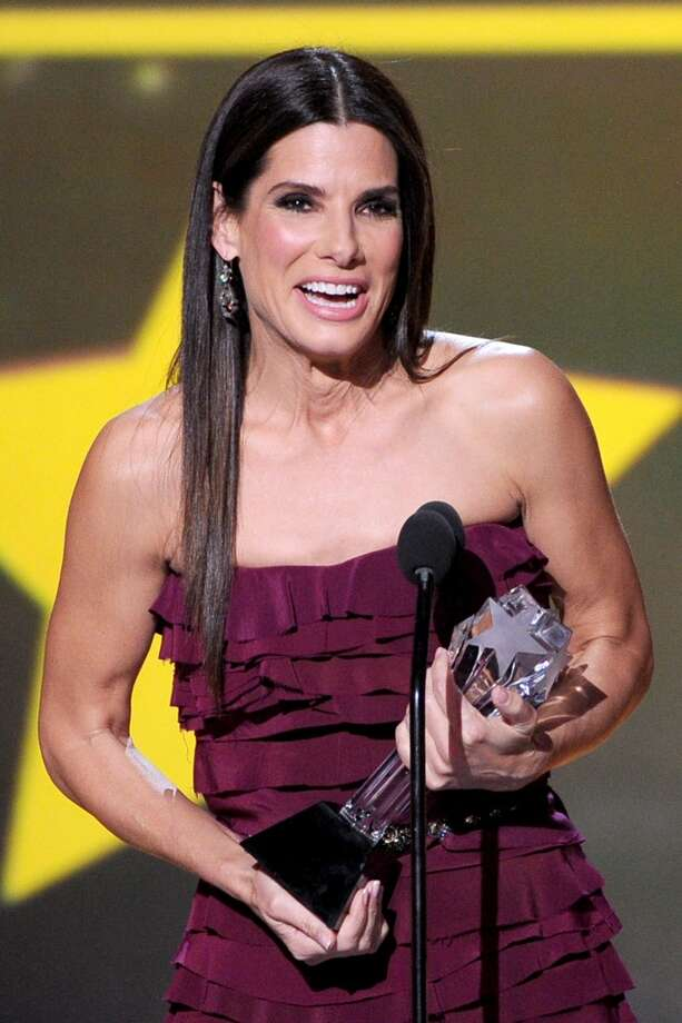 "Actress Sandra Bullock accepts the award for Best Actress in an Action Movie for ""Gravity"" onstage during the 19th Annual Critics' Choice Movie Awards at Barker Hangar on January 16, 2014 in Santa Monica, California. Photo: Kevin Winter, Getty Images"