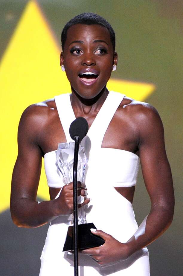 "Actress Lupita Nyong'o accepts the Best Supporting Actress award for ""12 Years a Slave"" onstage during the 19th Annual Critics' Choice Movie Awards at Barker Hangar on January 16, 2014 in Santa Monica, California. Photo: Kevin Winter, Getty Images"