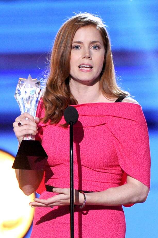 "Amy Adams accepts the award for Best Actress in a Comedy for ""American Hustle"" onstage during the 19th Annual Critics' Choice Movie Awards at Barker Hangar on January 16, 2014 in Santa Monica, California. Photo: Kevin Winter, Getty Images"