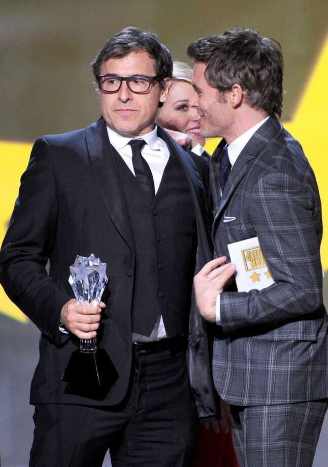 "Director David O. Russell (L) accepts the Best Comedy award for ""American Hustle"" from actor James Marsden onstage during the 19th Annual Critics' Choice Movie Awards at Barker Hangar on January 16, 2014 in Santa Monica, California. Photo: Kevin Winter, Getty Images"