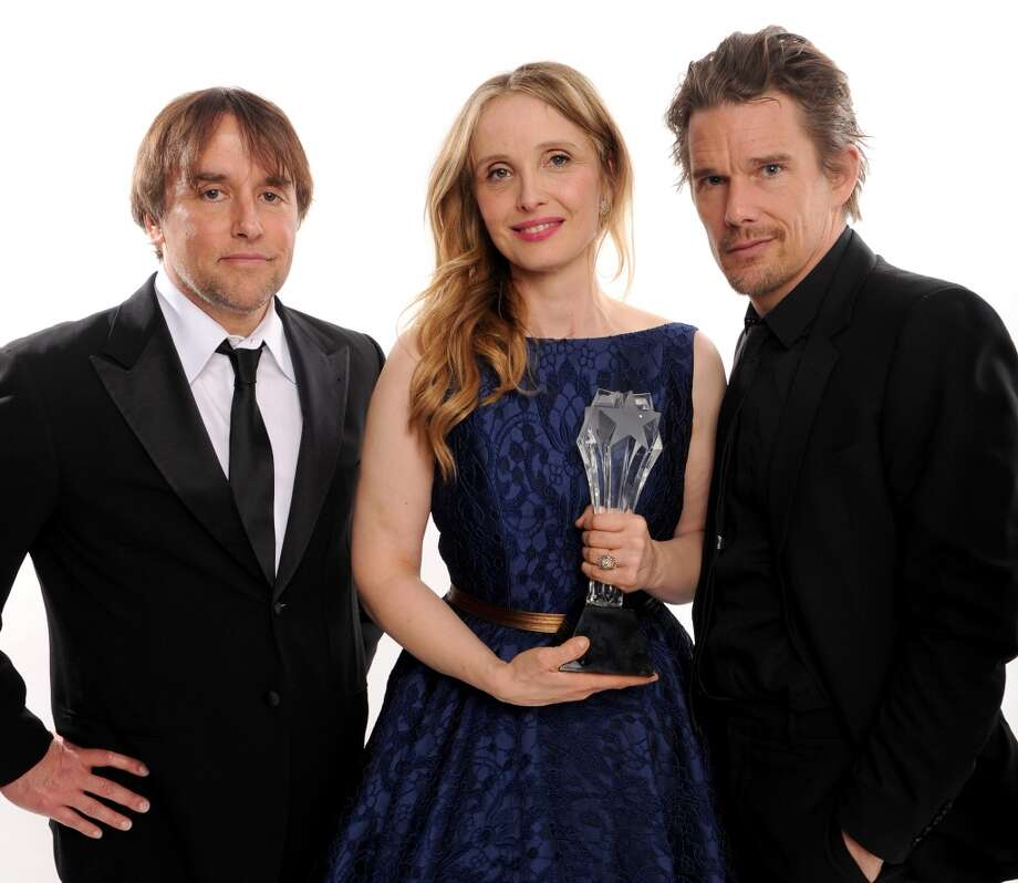 (L-R) Director Richard Linklater and actors Julie Delpy and Ethan Hawke, winners of the Louis XIII Genius Award, pose for a portrait during the 19th Annual Critics' Choice Movie Awards at Barker Hangar on January 16, 2014 in Santa Monica, California. Photo: Dimitrios Kambouris, Getty Images